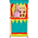 Child playing with wooden puppet theatre