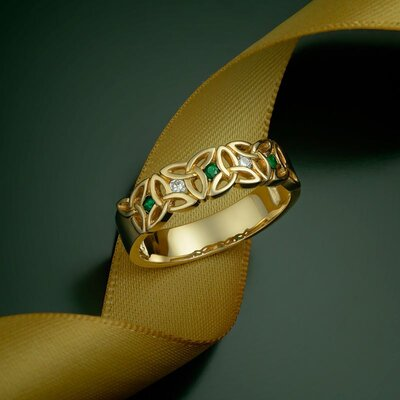 styled image of Solvar gold diamond and emerald trinity knot ring S2626