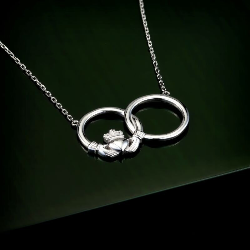Styled image of Solvar silver claddagh circle necklet S46370 on green background
