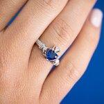 a model wearing Solvar september birthstone sapphire claddagh ring