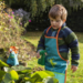kid playing with frog garden kit