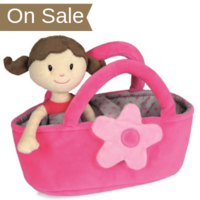 Rag doll Claire in her carrycot bed with magnetic flower clasp