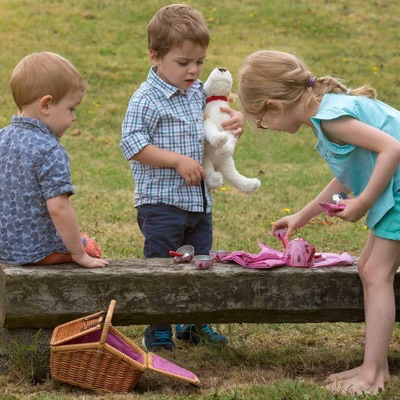 children having a teddy bear picnic w/tea set
