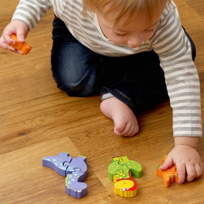 child playing with dino puzzle set