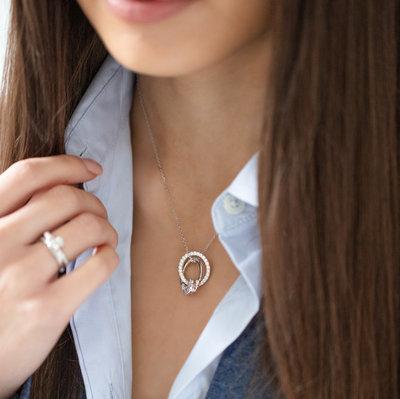 Model wearing circle claddagh pendant S46446