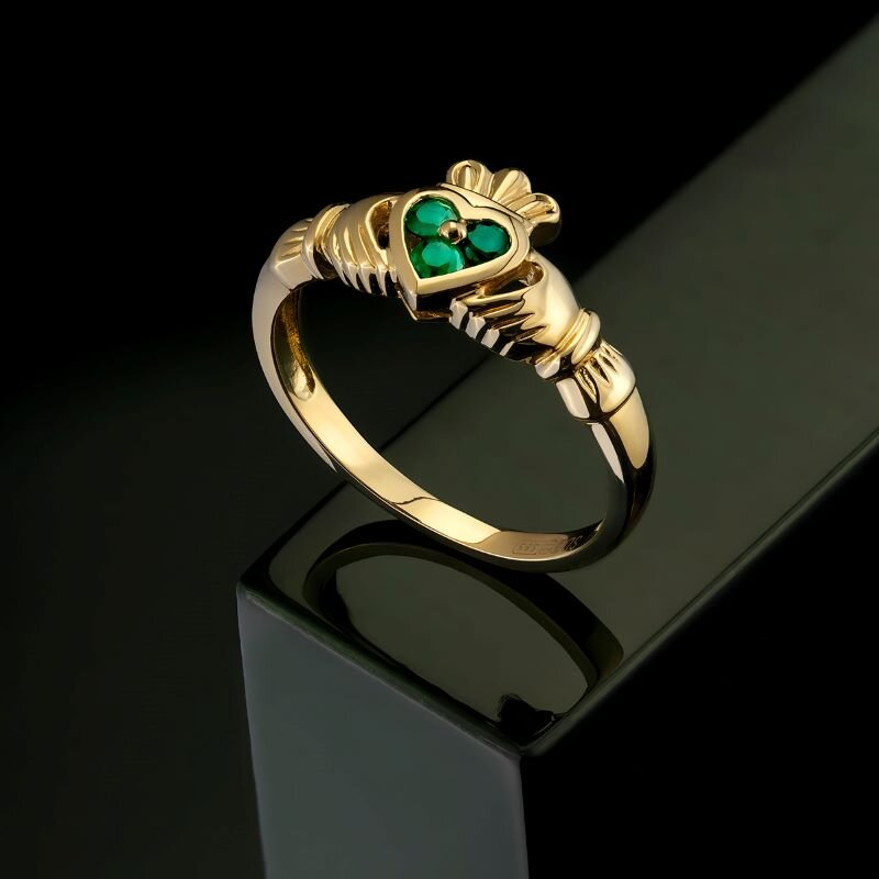 styled image of Solvar emerald heart claddagh ring S2466 on green background