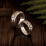 Styled image of laddies claddagh band S21007 and matching gents claddagh band ring
