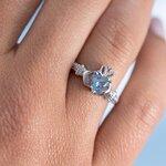 a model wearing Solvar december birthstone zircon claddagh ring