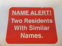 SIZE 36x28mm NAME ALERT. TWO RESIDENTS (ROLL 1000)