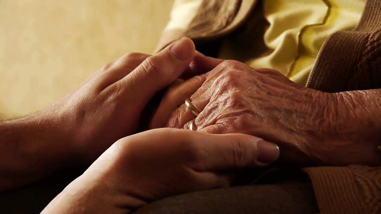senior-old-woman-young-man-hold-hand-skin-close-up_4kisgumxg__F0000.png