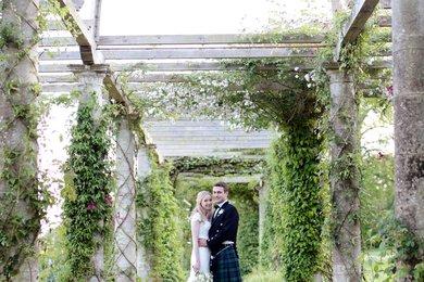 Bride and Groom standing in West Dean Gardens