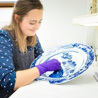 MA Conservation Student at West Dean College with Ceramic blue plate