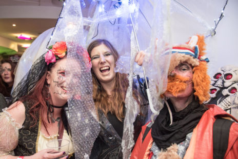 A group of people in fancy dress at a party.