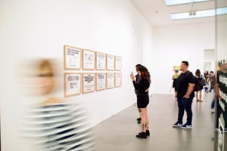 Blurred Photo Of Visitors In A Gallery