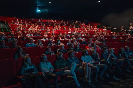 Cinema Audiences In Red Seats