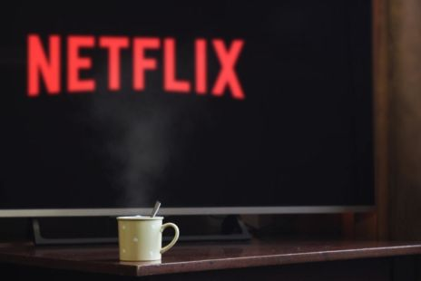 Coffee Cup With Netflix In Background