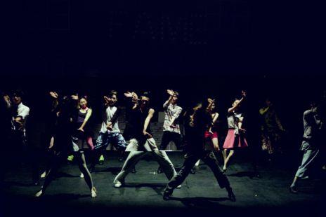 Dancers On Dark Stage