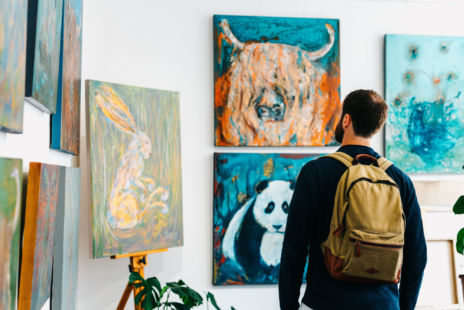Man Looking At Art In Gallery
