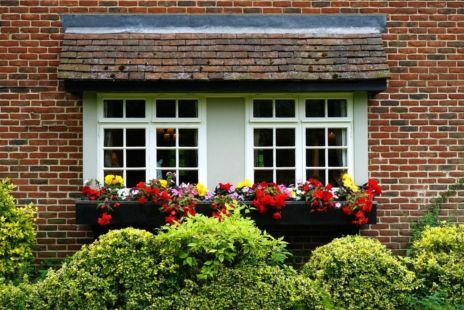 Red Brick House With Window With Flower Boxes