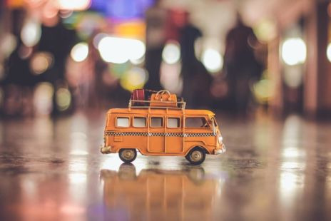 Toy Bus With Suitcases On Roof