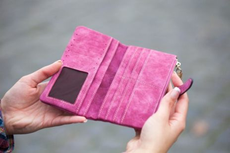 Woman Holding Open Wallet