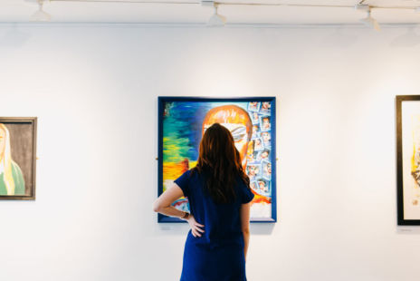 Woman Looking At Painting In Gallery