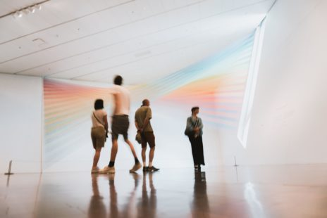 Four people standing in a museum
