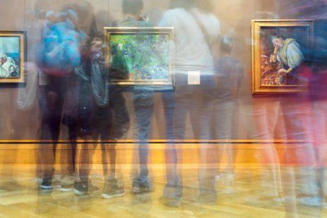People looking at paintings in an art gallery