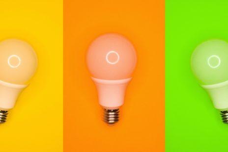 Three lightbulbs on three plain coloured background