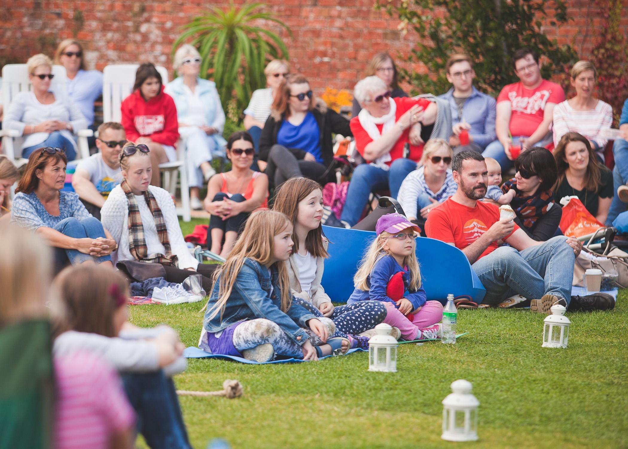children-sitting-on-lawn-in-a-crowd.jpg?mtime=20180430094921#asset:919