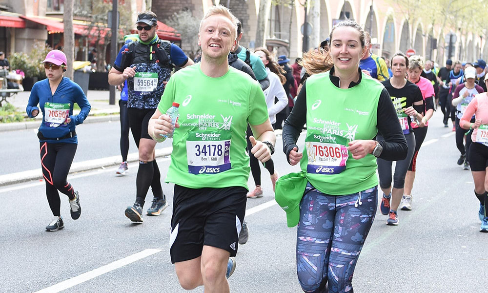 Schneider Electric - Ben running with colleague at Paris Marathon