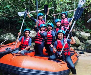 Exyte women go water rafting as APAC Photo Contest winners