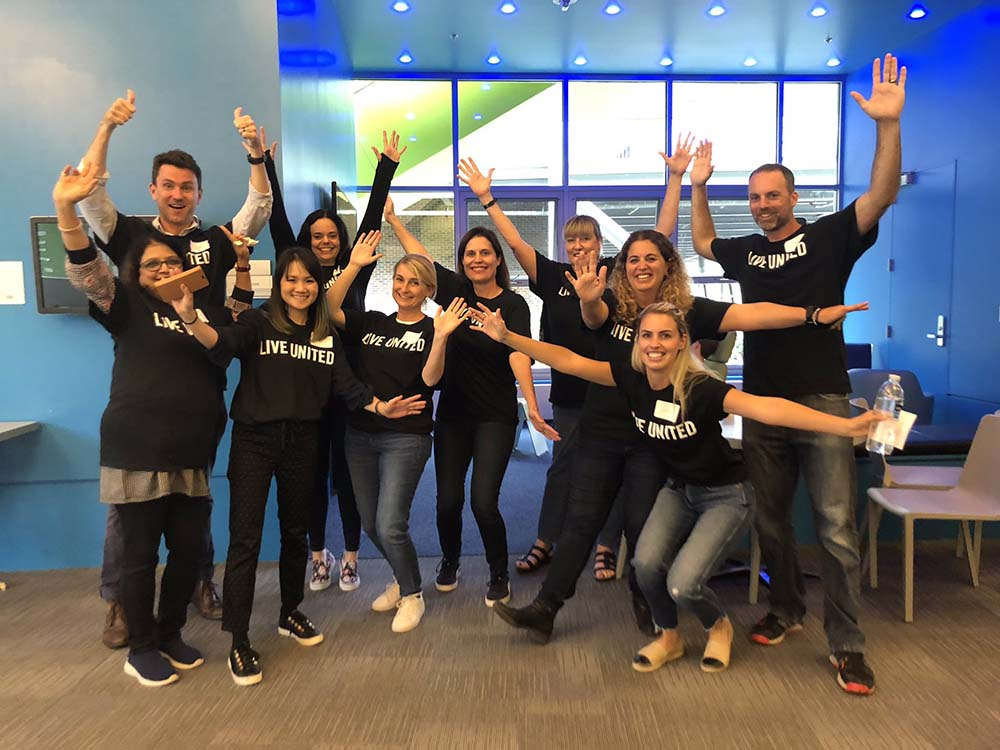 F5 employees pack lunches for kids to increase food security