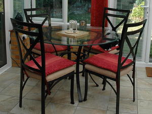 Metal Framed Glass Top Dining Table And Chairs In Bembridge