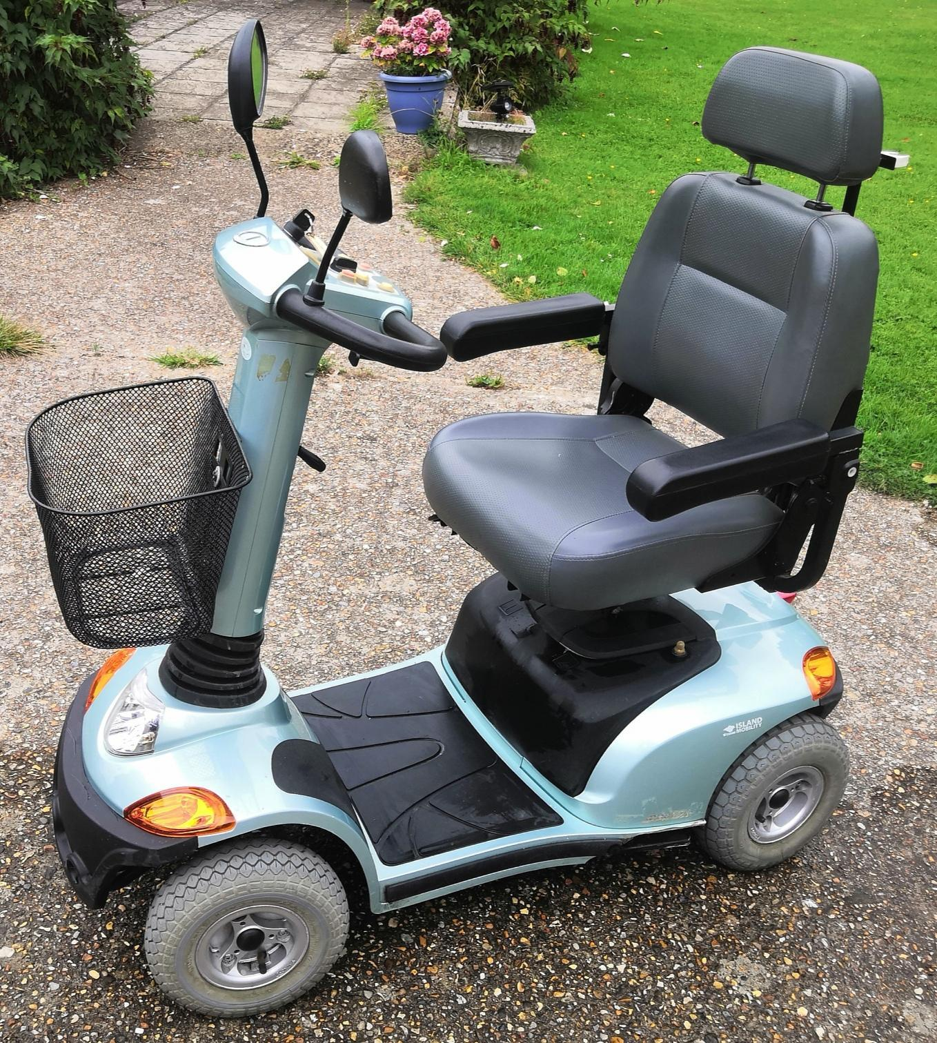 Mobility scooter with spare key and manuals and charger