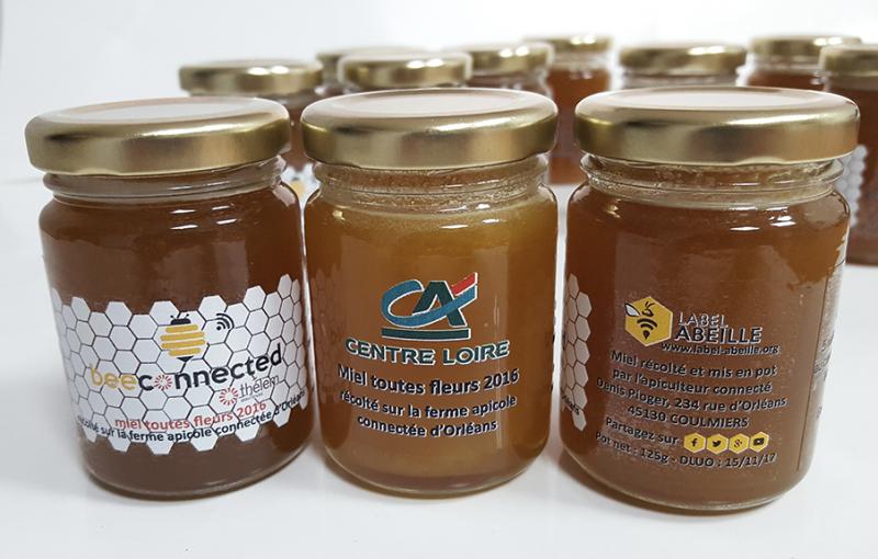 Pots de miel personnalisés aux couleurs des clients