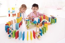 Colourful domino sets for building runs