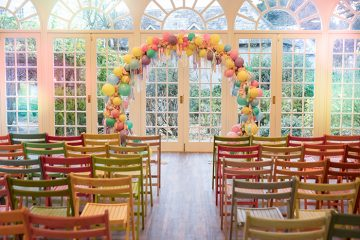 Candy floss hair, a button bouquet and a sea of balloons!