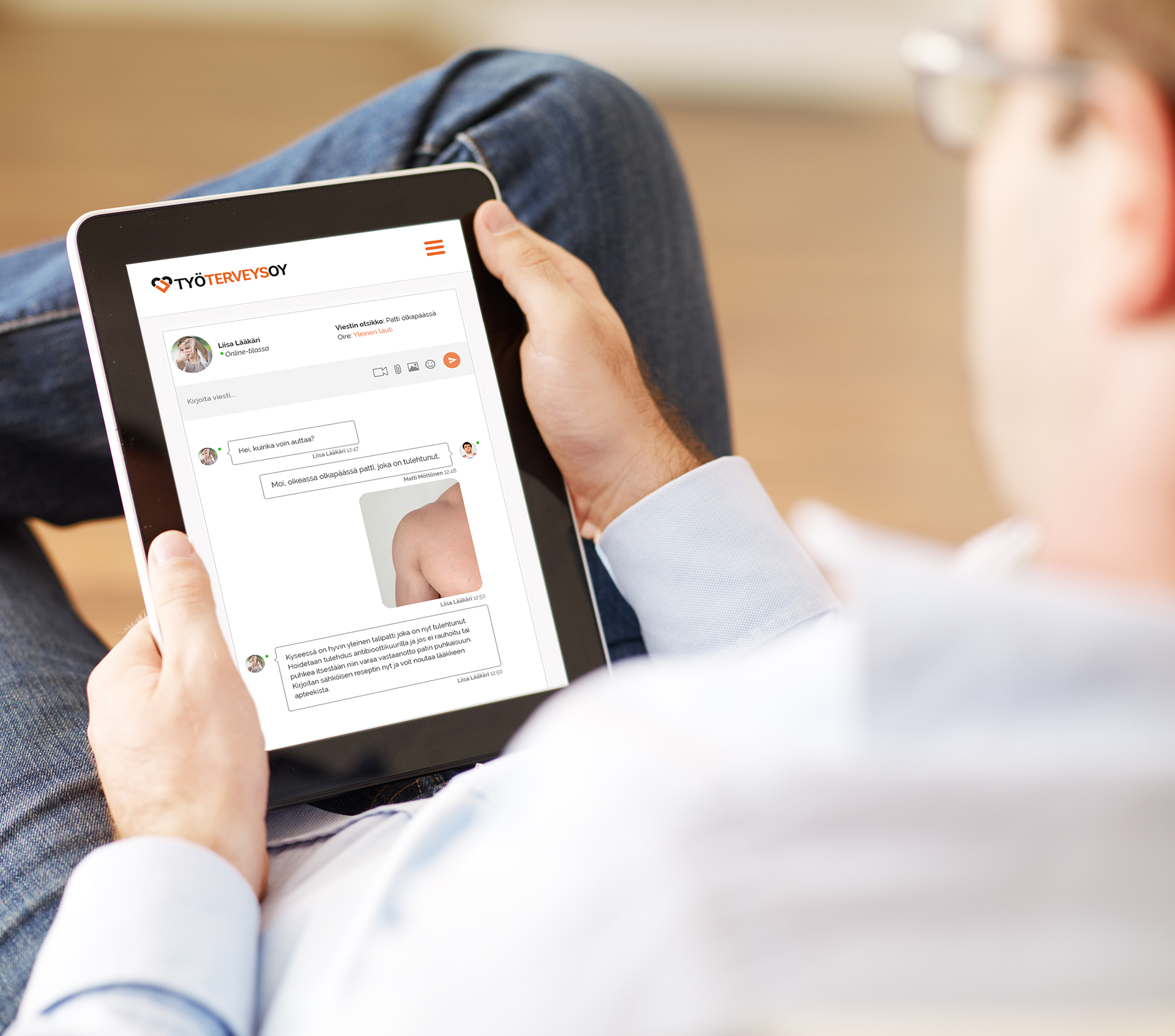 Man holding a  digital tablet and reading news