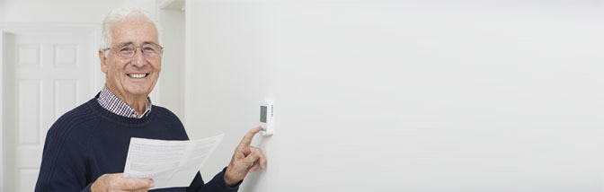 pensioner using thermostat