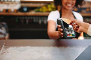 Customer using contactless payments in a cafe