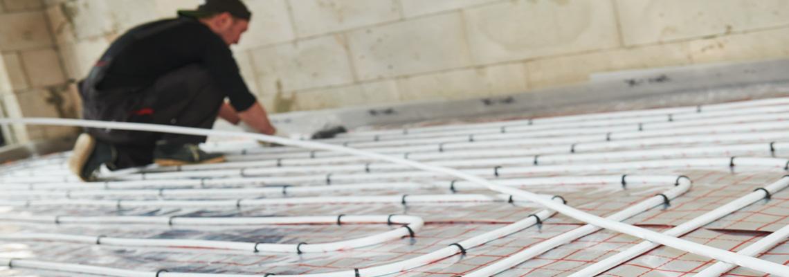 A heating engineer fitting underfloor heating