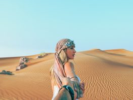 Girl in the desert of Dubai
