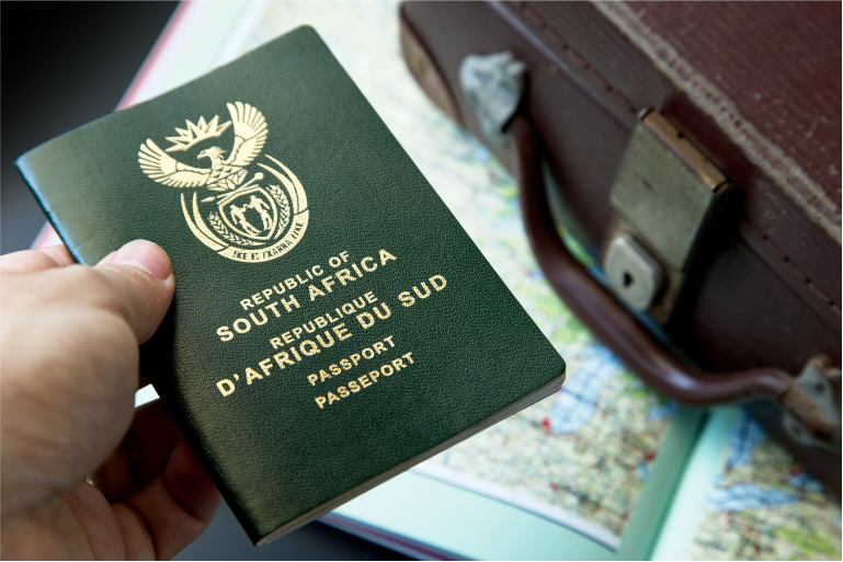 Someone holding a South African identification document.