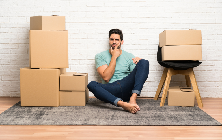 Guy confused by all the boxes he needs to pack.