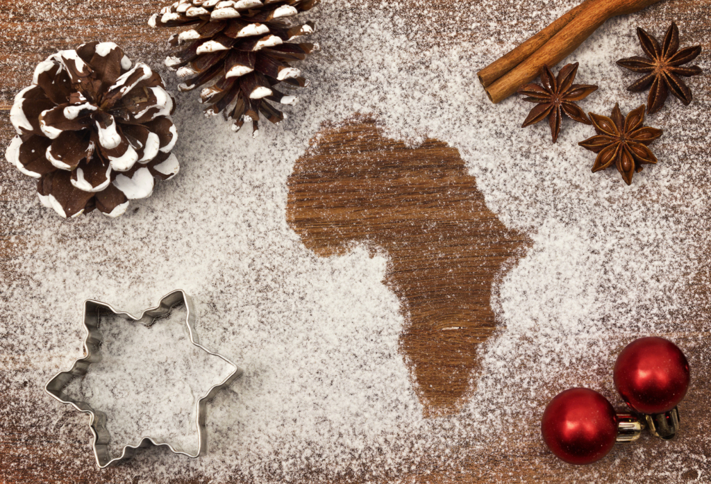 festive-flour-dusted-christmas-decorations-with-a-map-of-africa-motif-and-red-christmas-baubles