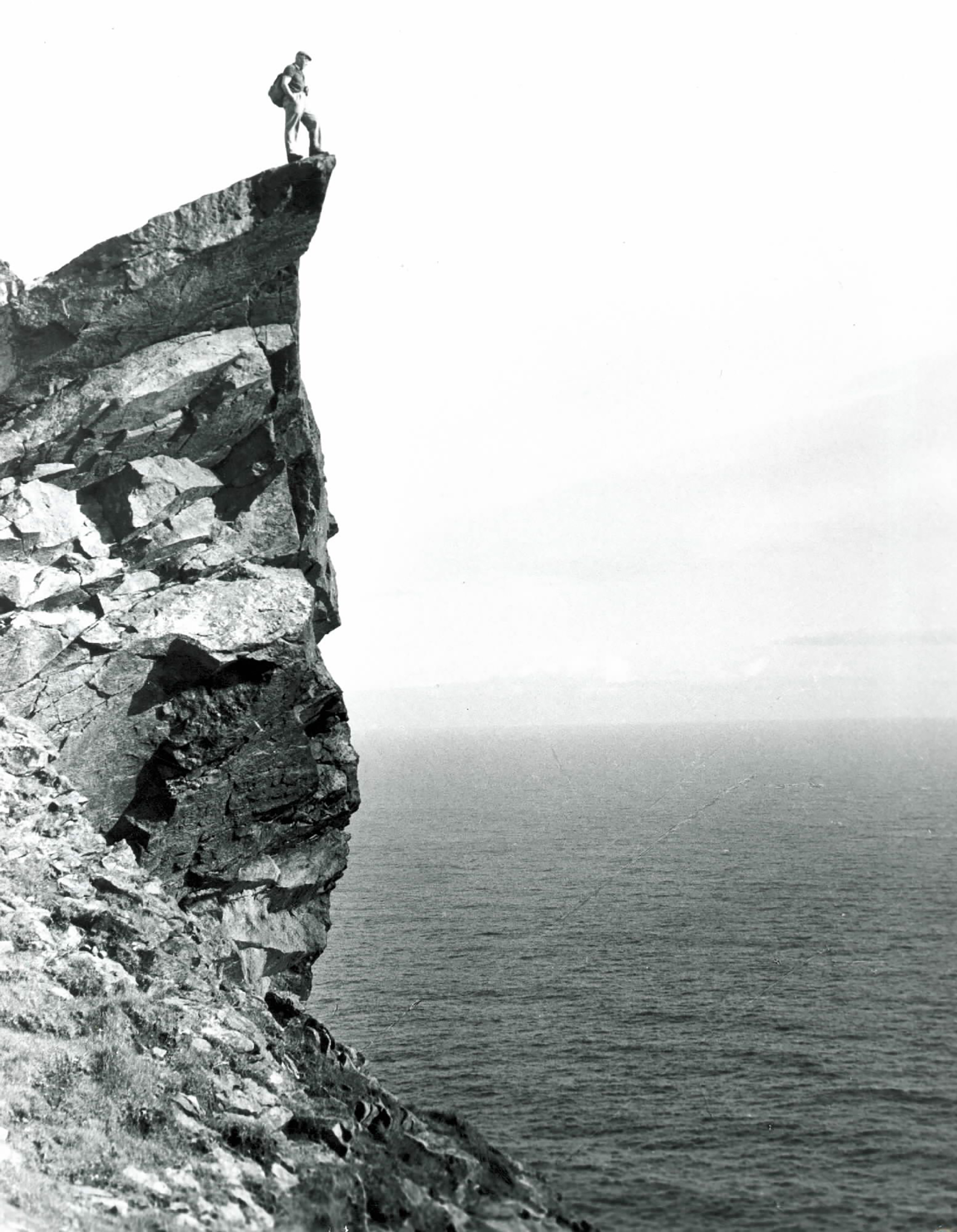 Fig. 6: Glass plate negative of a man on the Lover's Stone, Hirta, #352 © National Trust for Scotland, St Kilda