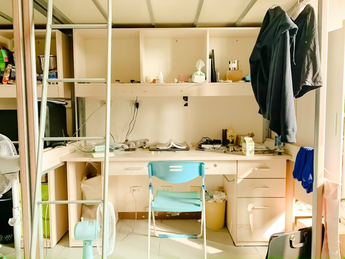 A blue chair sitting at a loft desk, which is one of the best storage ideas