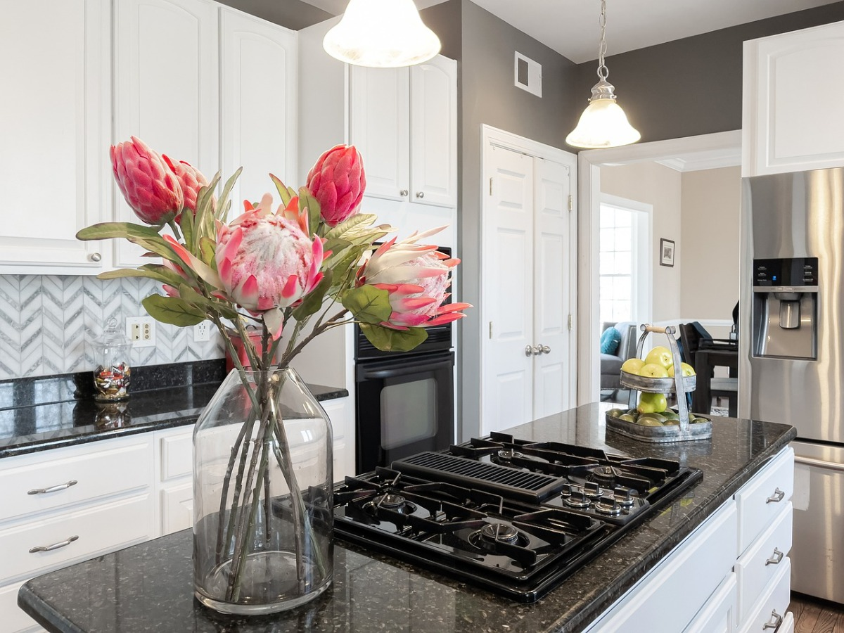 Fresh flowers set on a counter, one of the best tips for staging a home for quick sale