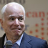 U.S. Sen. John McCain, R-Ariz., reacts as a lightning hit a nearby building while answering to questions from students of the Japan-America Student Conference (JASC) at the Tokyo American Center in Tokyo, Japan, Wednesday, Aug. 21, 2013. (AP Photo/Franck Robichon, Pool)